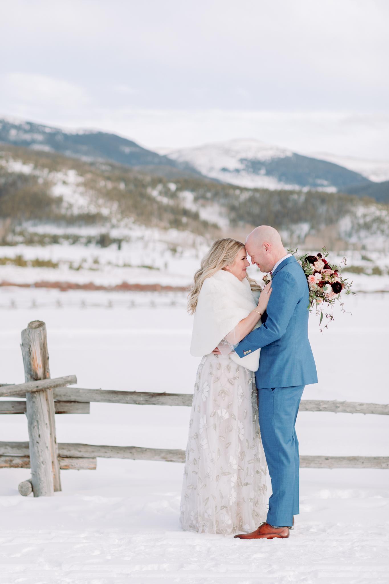 Devils-Thumb-Ranch-Tabernash-Colorado-Winter-Outdoor-Wedding-Bride-and-Groom-Portraits