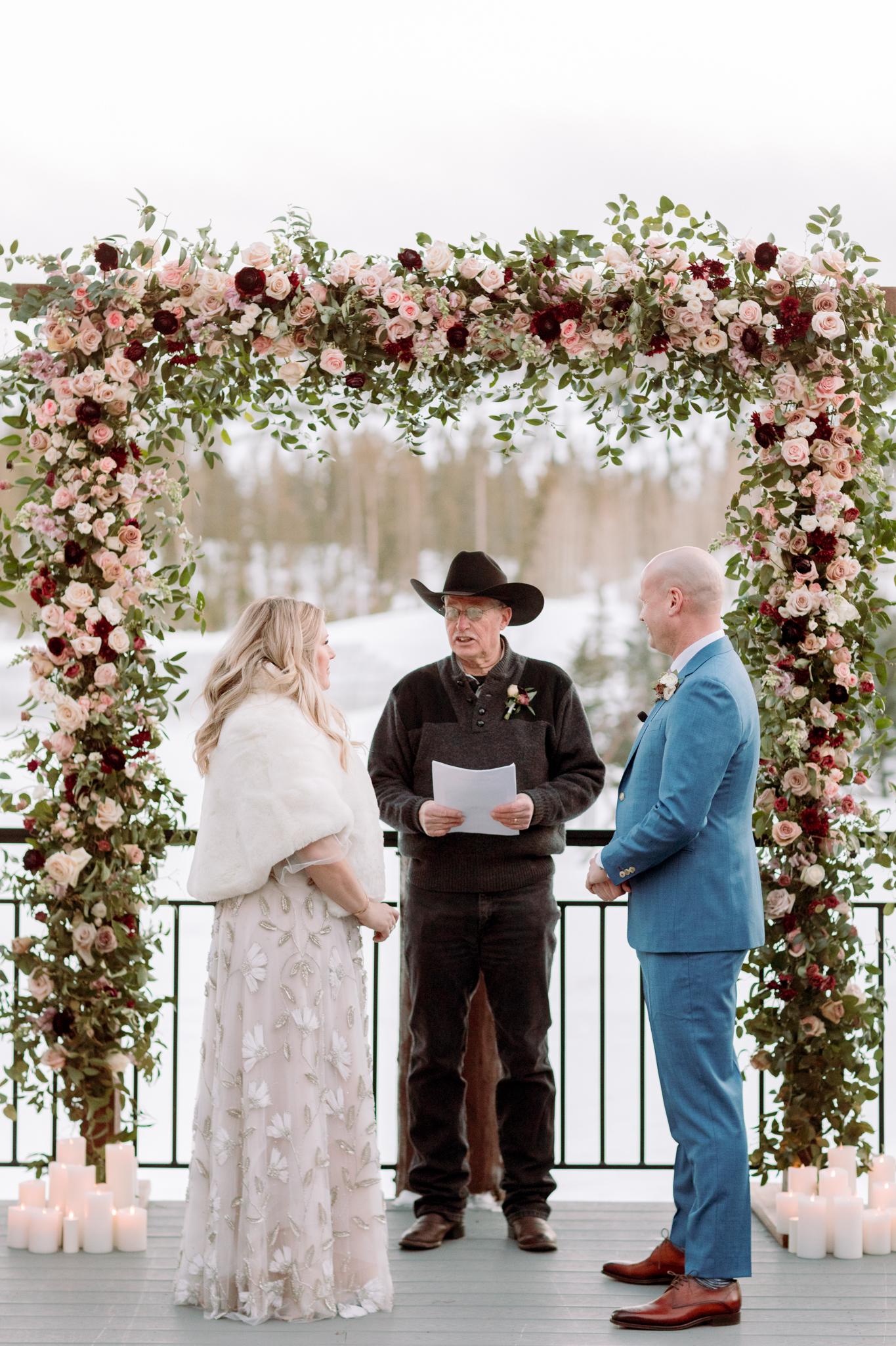 Devils-Thumb-Ranch-Tabernash-Colorado-Winter-Broad-Axe-Barn-Wedding-Deck-Ceremony