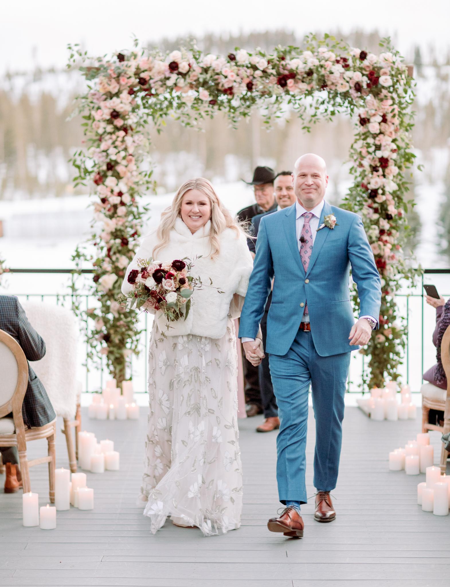 Devils-Thumb-Ranch-Tabernash-Colorado-Winter-Broad-Axe-Barn-Wedding-Deck-Ceremony-Bride-and-Groom-Recessional