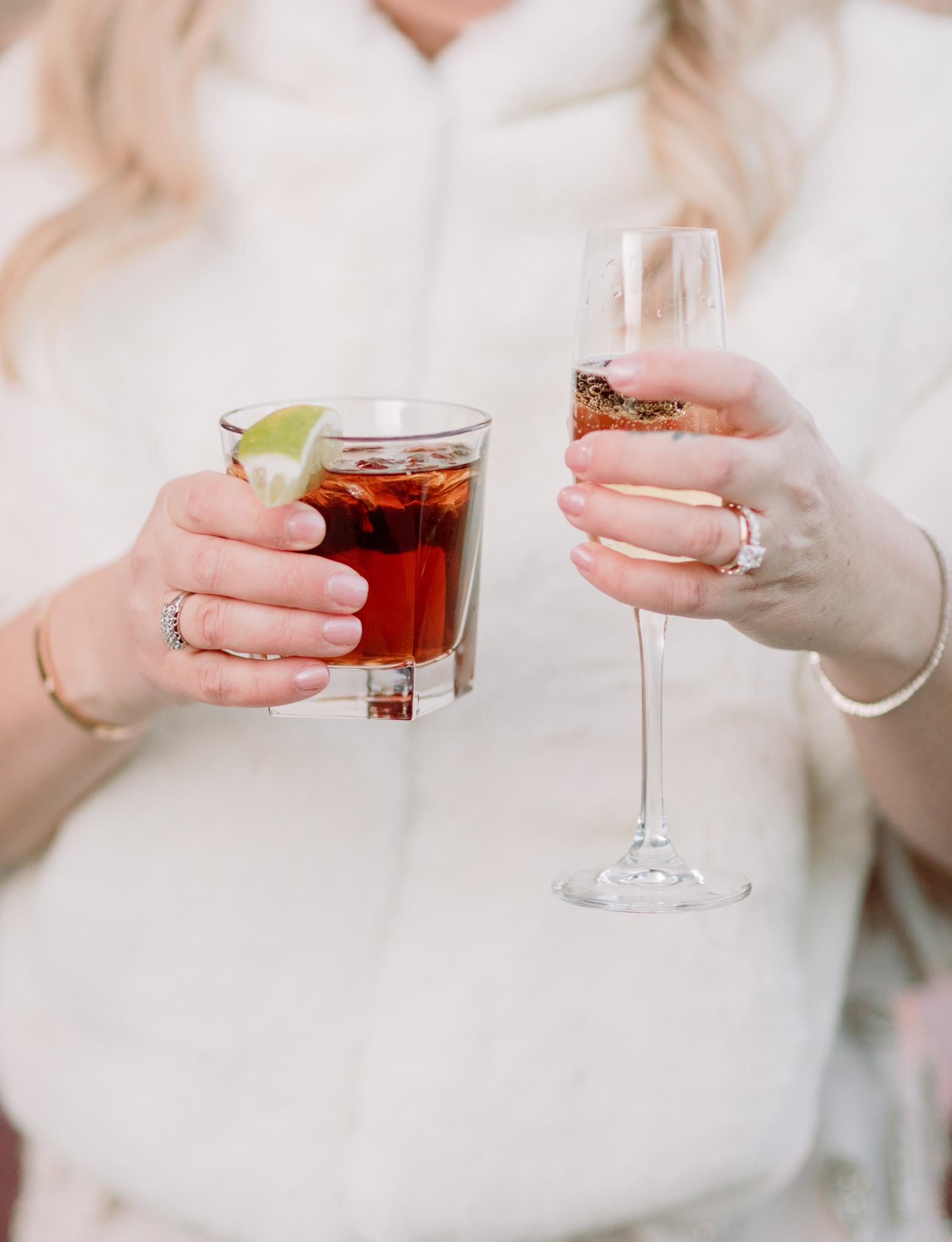 Devils-Thumb-Ranch-Tabernash-Colorado-Winter-Broad-Axe-Barn-Wedding-Deck-Ceremony-Bride-and-Groom-Signature-Cocktail