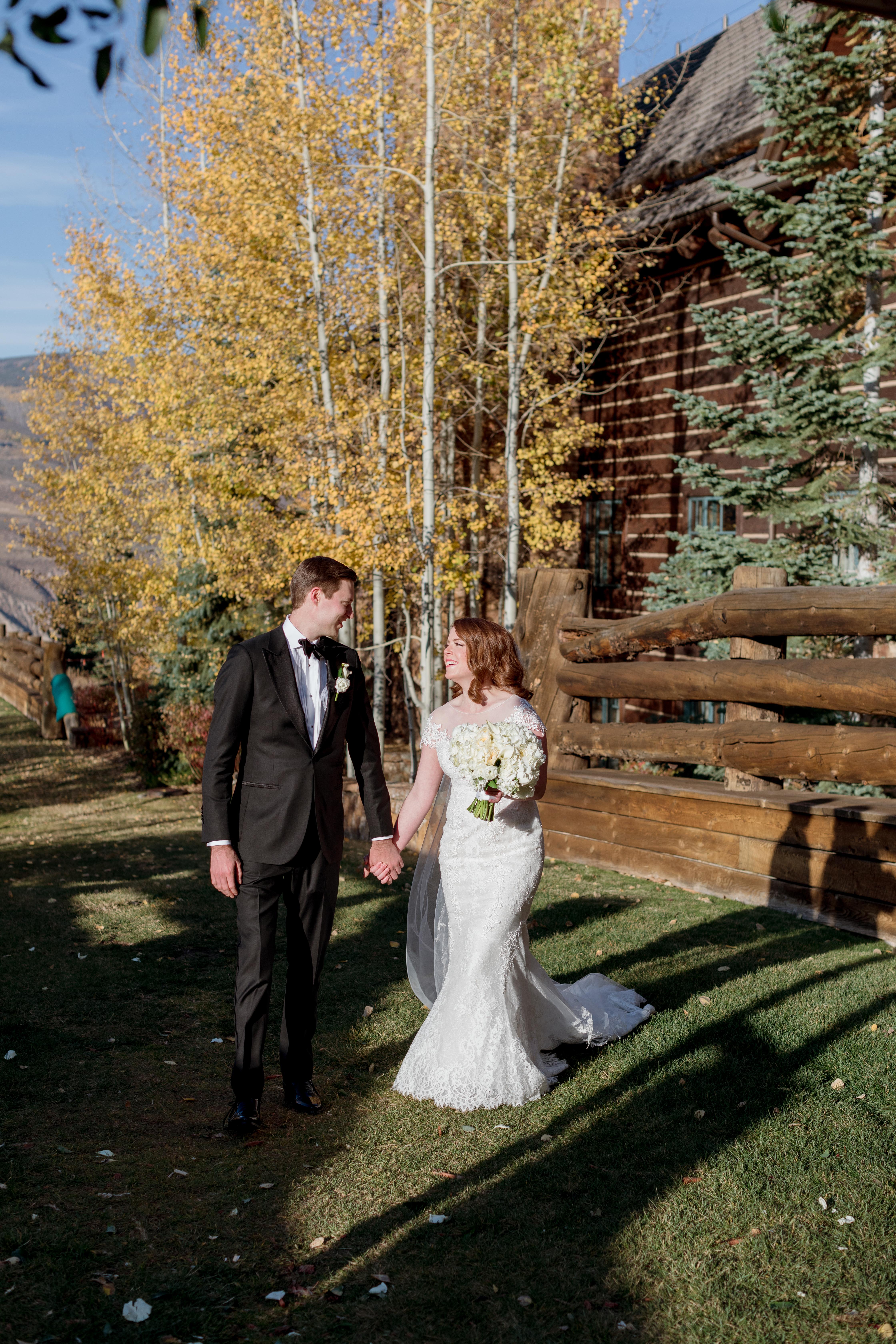 Ritz-Carlton-Bachelor-Gulch-Beaver-Creek-Colorado-Fall-Wedding-Bride-Groom-Skiers-Bridge
